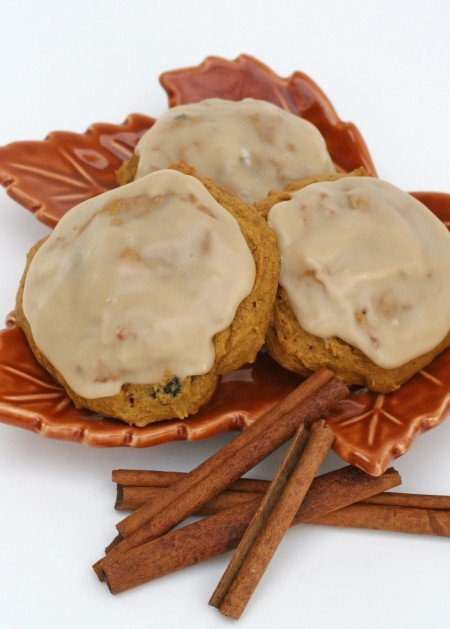 pumpkin cookies with maple icing on leaf plate