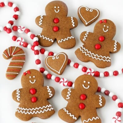 decorated gingerbread cookies with red garland