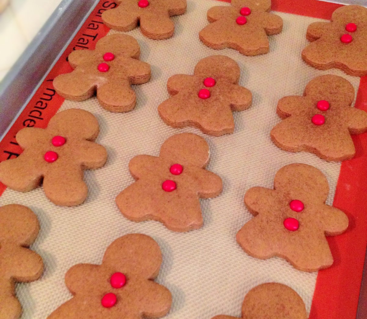 gingerbread cookies ready to be baked on baking sheet