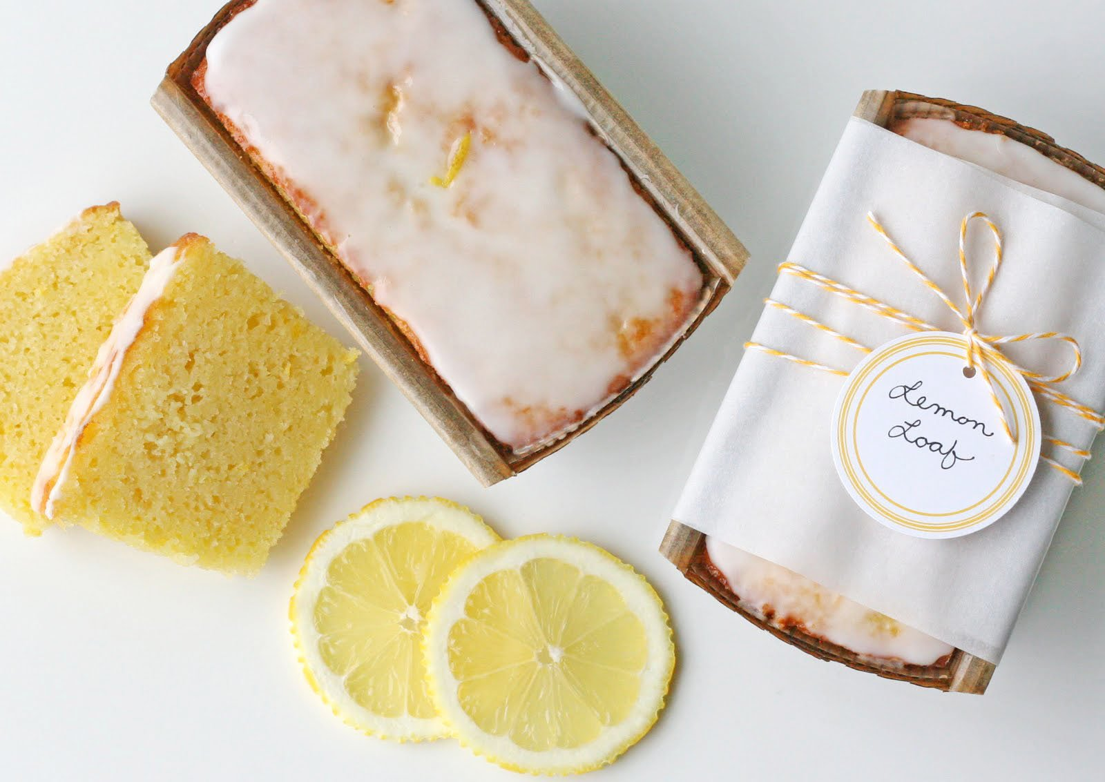 lemon bread recipe with full loaf and slices of lemon bread on white background