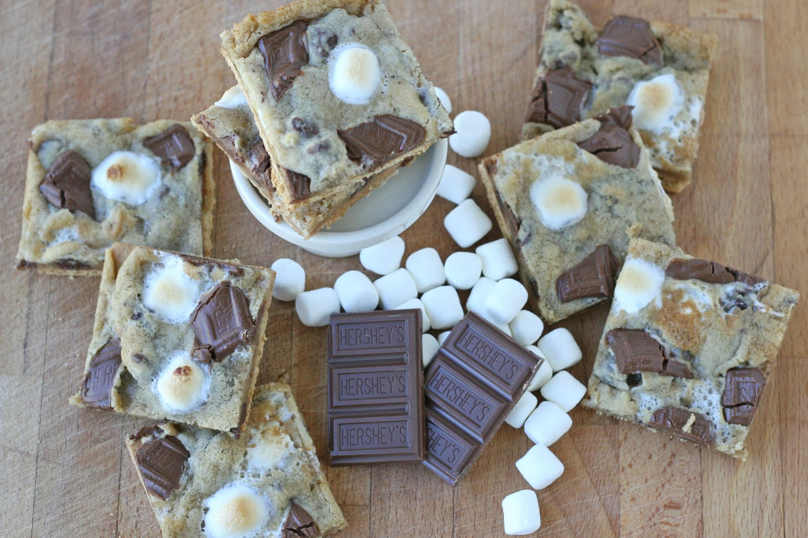 graham cracker smores surrounded by chocolate and marshmallows
