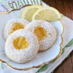 lemon cookies with lemon curd center on white plate
