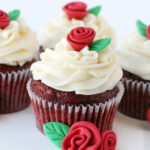 easy red velvet cupcakes with cream cheese frosting thre cupcakes on white background square