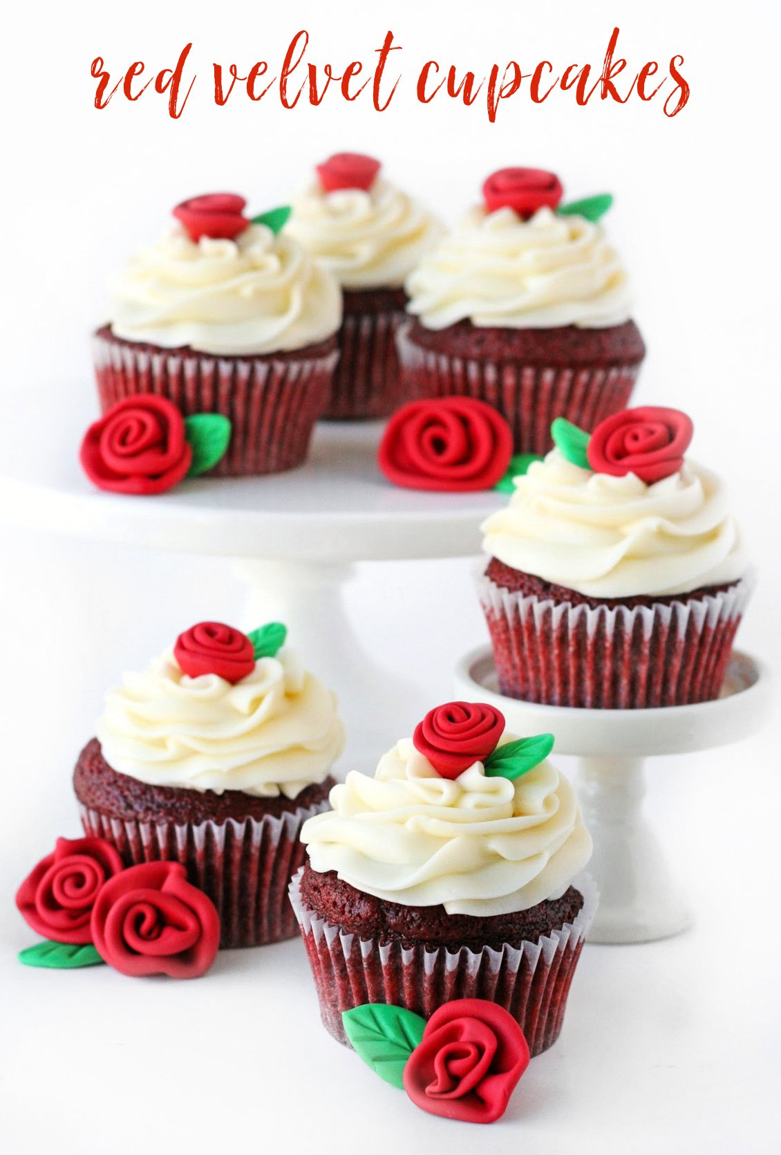 best red velvet cupcakes with cream cheese frosting and fondant roses on white cake pedestals with text overlay