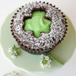 chocolate cupcake with shamrock cut out