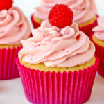 raspberry vanilla cupcakes with raspberry cream cheese frosting in pink cupcake liner square