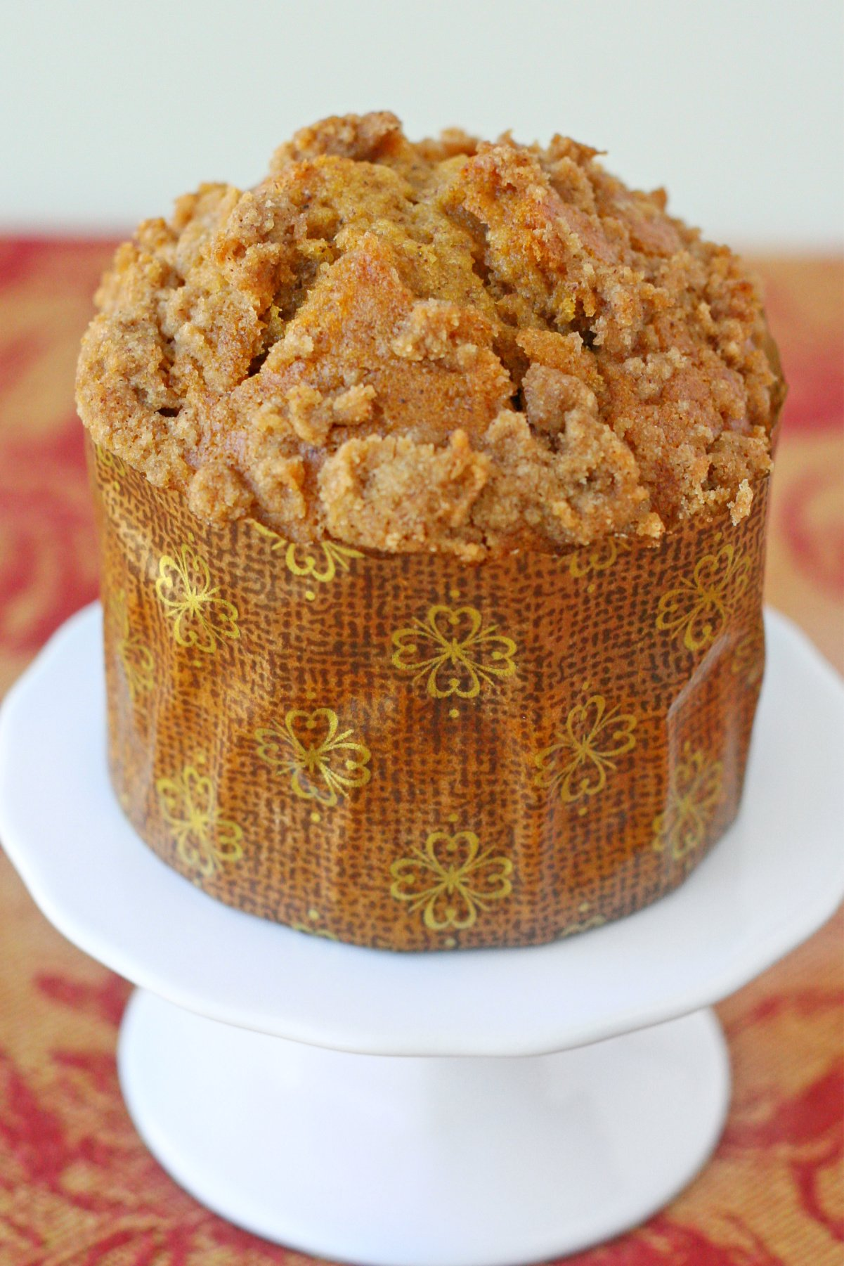 single pumpkin muffin on cupcake stand