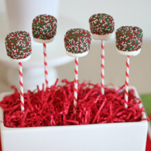 marshmallows covered in chocolate on sticks