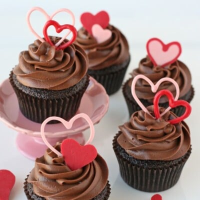 chocolate cupcakes with chocolate frosting and pink hearts