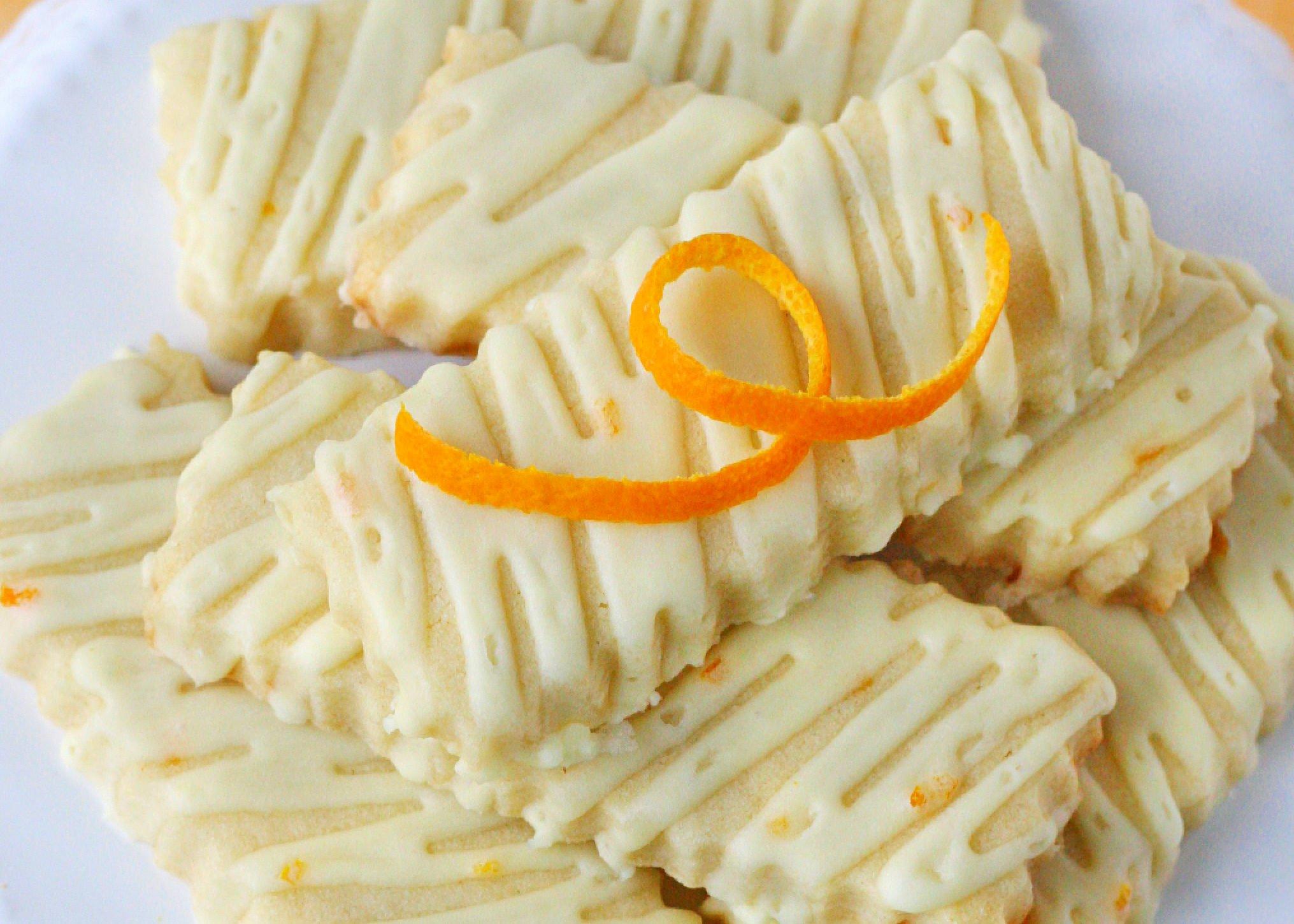 close look at orange sugar cookies with an orange glaze.