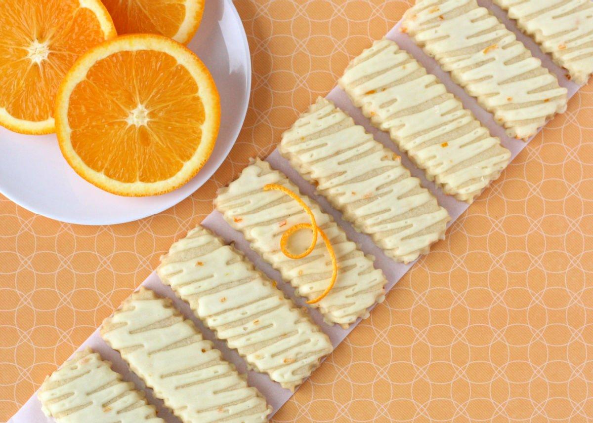 orange sugar cookies lined up in a diagonal line.