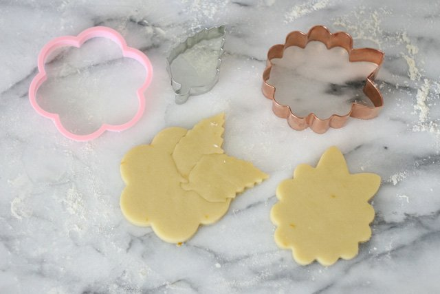 Cutting out hydrangea cookies