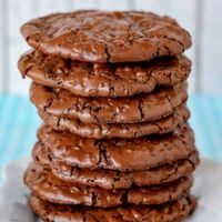flourless chocolate cookies stacked tall on white plate square image