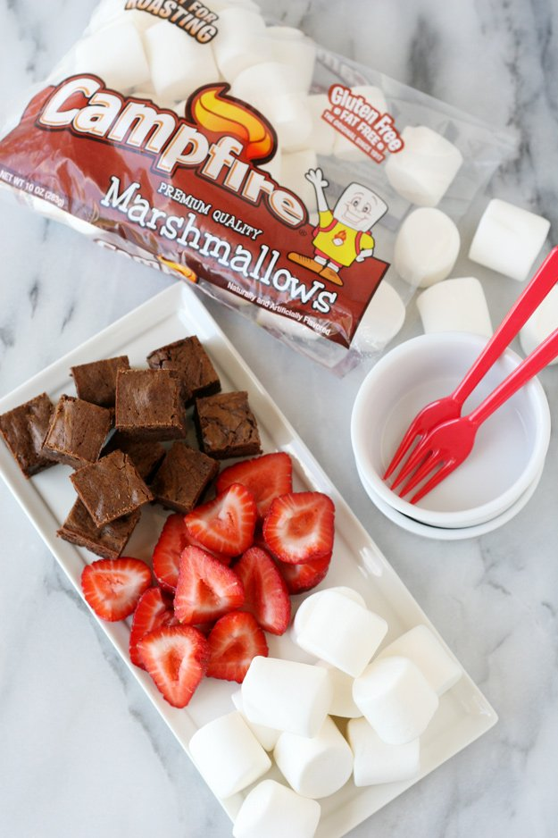 Create the best s'mores treat ever with rich brownie bites, fresh strawberries and roasted marshmallows... YUM!