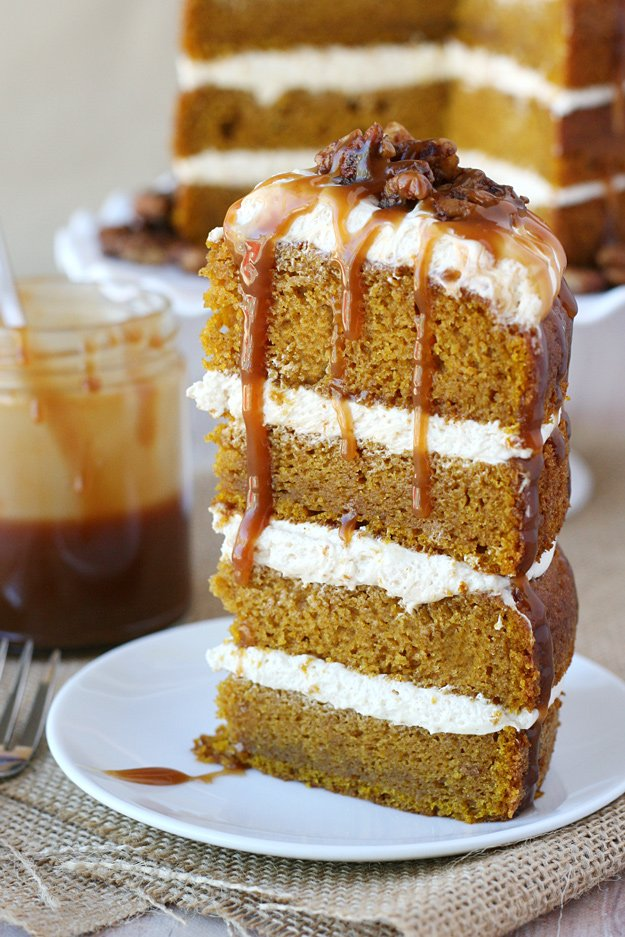 Simply the PERFECT cake for fall! Moist and flavorful Pumpkin Cake is paired with Salted Caramel Frosting, Candied Pecans and even more amazing caramel!
