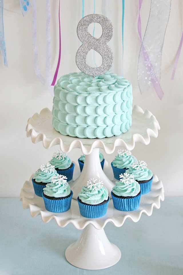 Simply beautiful cake and cupcakes perfect for a Frozen party or any winter theme!