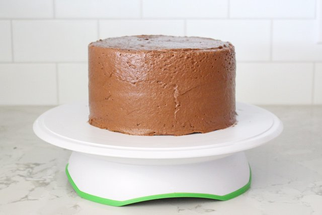 Simple frosting technique for a delicious Chocolate Malt Cake