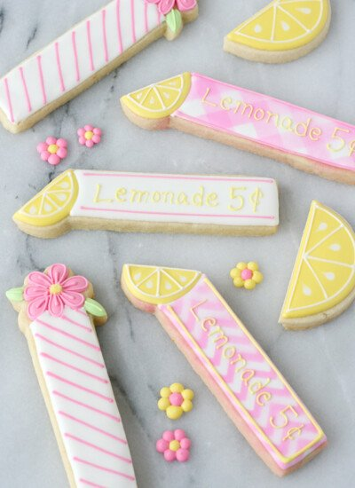 These adorable Lemonade Cookie Sticks are perfect for a lemonade stand or lemon themed party!