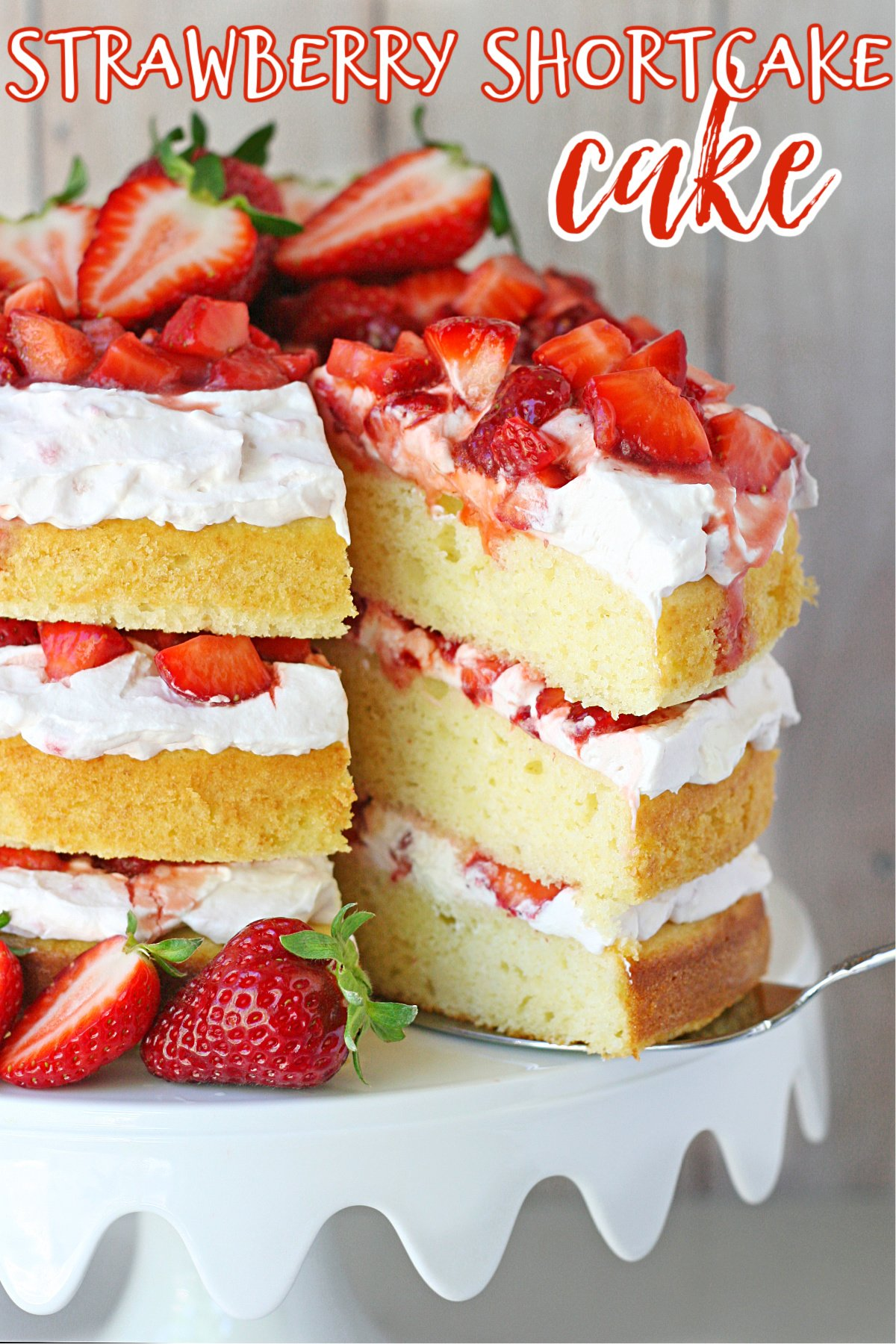 strawberry shortcake cake recipe on white cake stand with text overlay