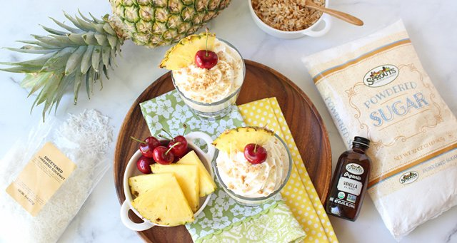 Pina Colada Cheesecake Mousse with napkins and ingredients top down view