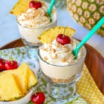 pina colada mousse with pineapple wedge garnish square