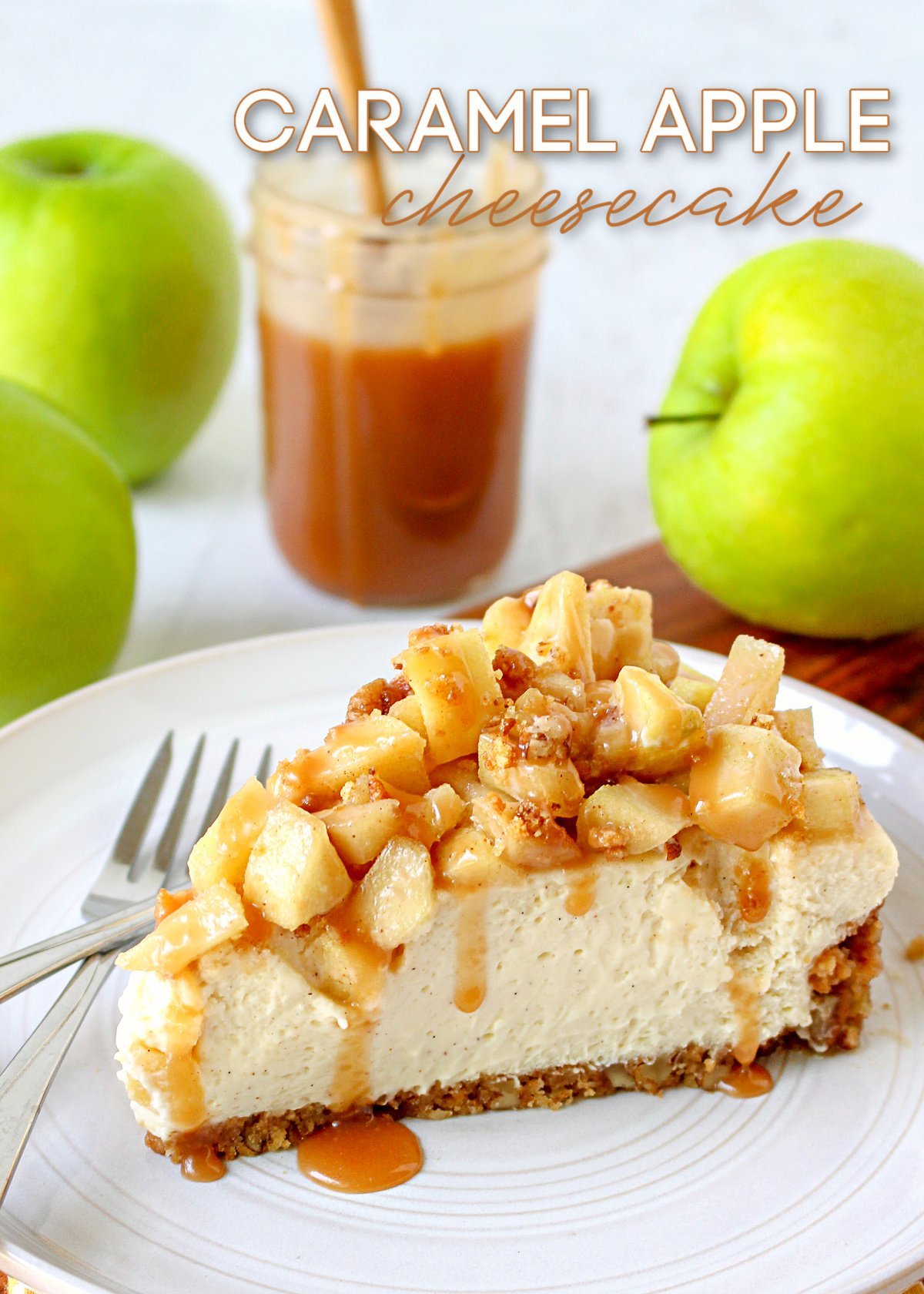 caramel apple cheesecake slice on white plate with green apples and caramel sauce in background title overlay at top